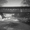 A black and white  Digital Art photo of a covered Bridge in Maine