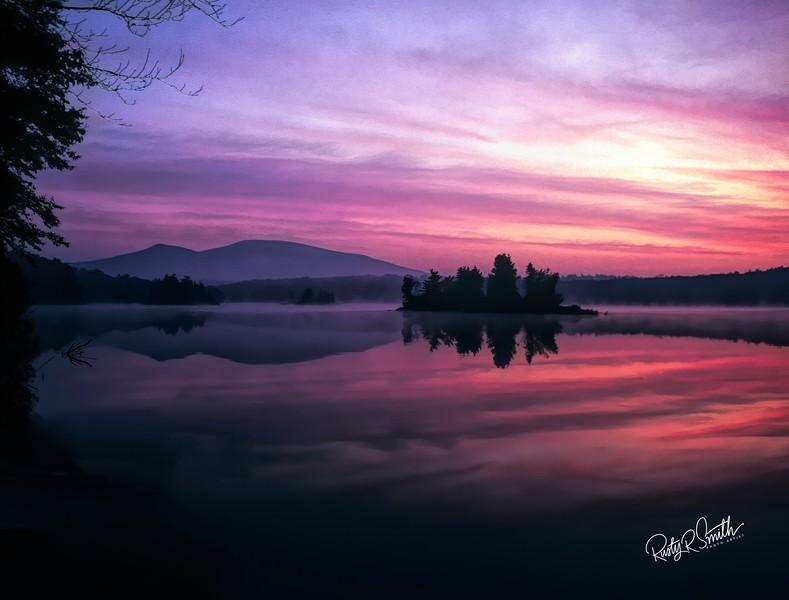 Sunrise over Sebago lake Maine.