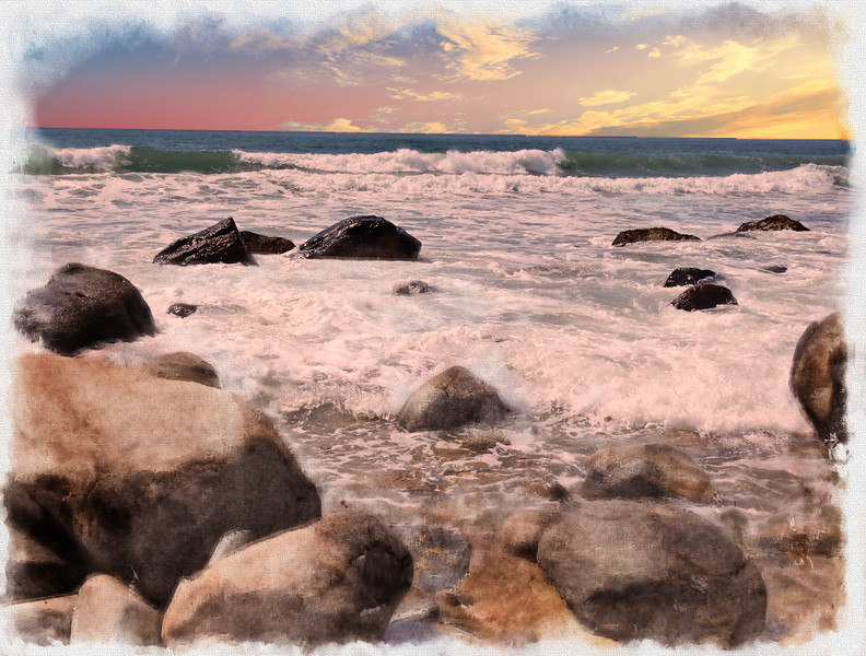 Waves washing in on a rocky beach