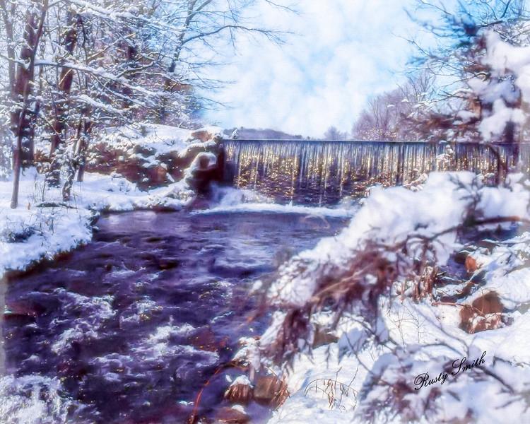 Small stream, snowy scene and waterfalls.