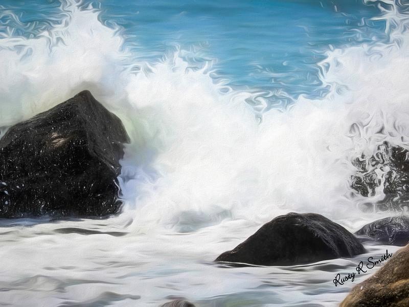 Waves  breaking over rocks.