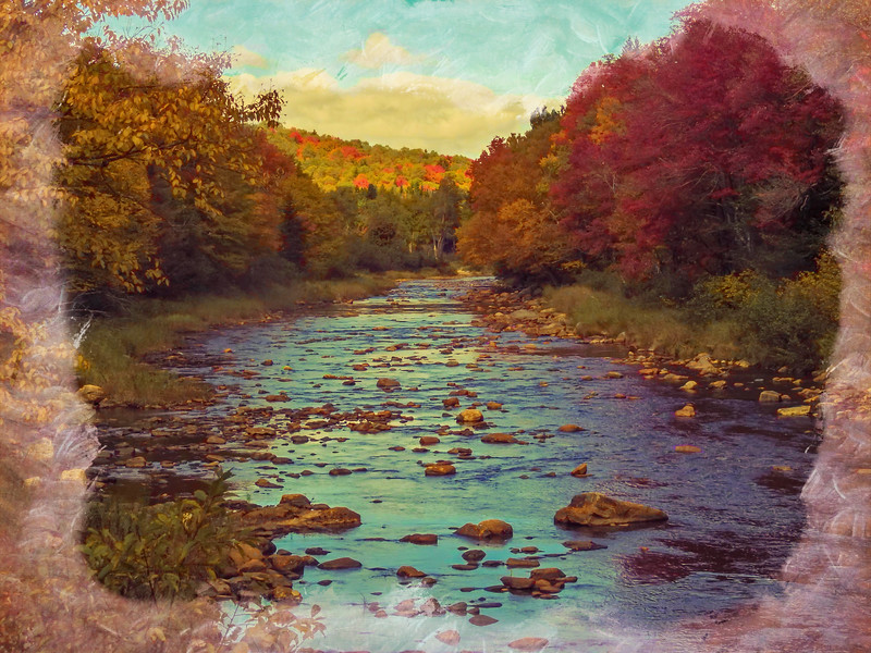 A view of the Deerfield river running through Fall Foliage.