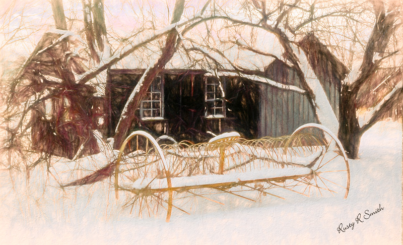 horse drawn dump hay rake in winter scene.