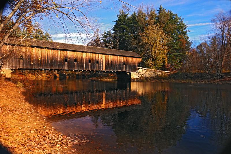 A horizontal stock photo of the Hemlock Covered Bridge near Fryeburg Maine. Bridge spans the old course of the Saco River.