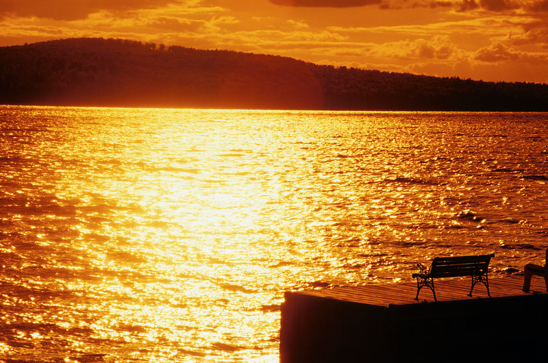 A horizontal photo of a beautiful sunset over lake brassua in northern Maine.