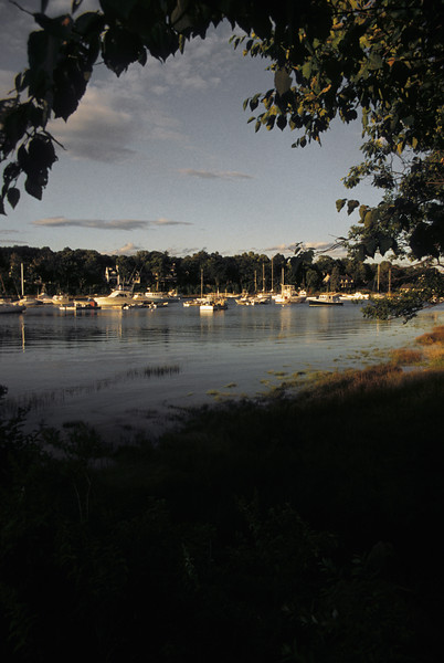 A vertical stock photogrph of York Harbor Maine late summer evening.