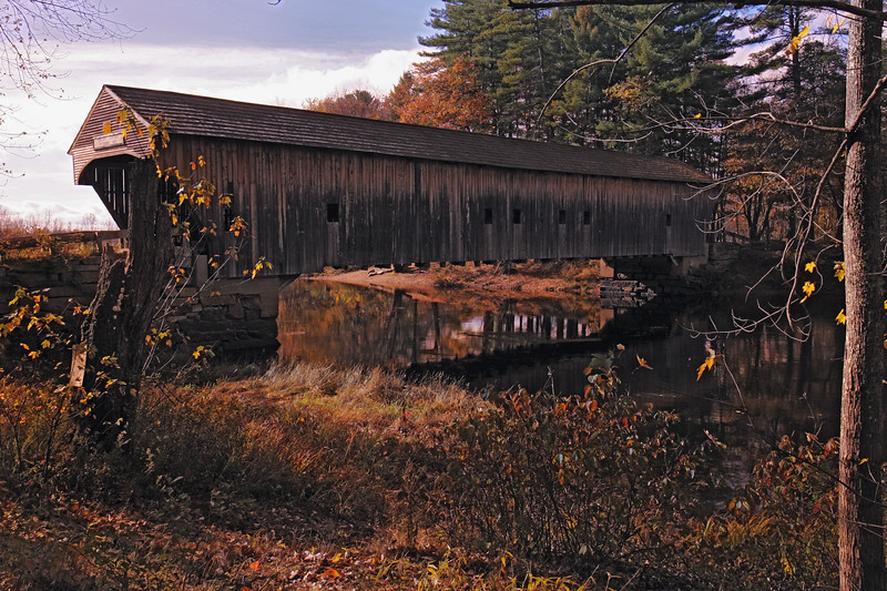 A horizontal stock photo of the Hemlock Covered Bridge near Fryeburg Maine. Bridge spans the old course of the Saco River.