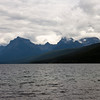 A horizontal stock photograph of mountains surrounding Lake McDonald. Low hanging clouds.  West Glacier Nat. Park.