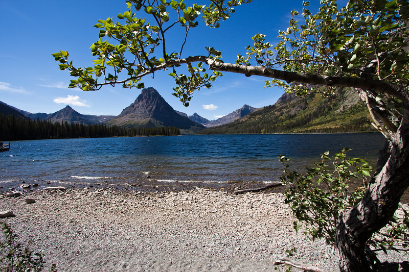 A horizontal stock photograph of  the mountains surrounding the Two Medicine area of Glacier National Park