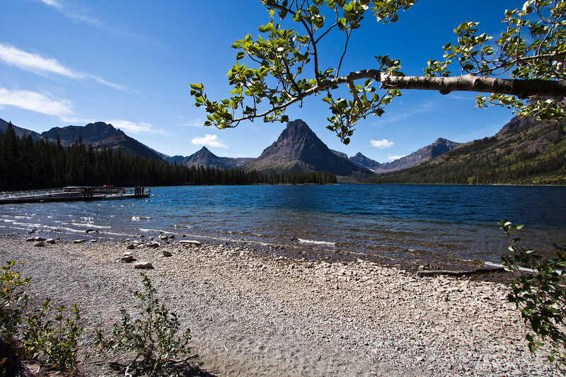 A horizontal stock photograph of Two Medicine Lake ,Glacier National Park, surrounded by mountains