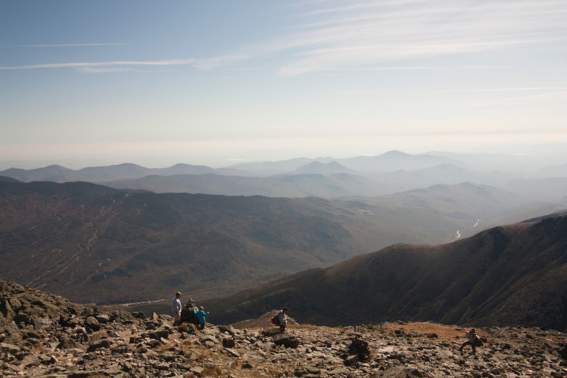 A horizontal stock photograph  of hikers finishing the long hike up Mt. Washington, New Hampshire