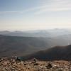 A horizontal stock photograph  of hikers finishing the long hike up Mt. Washington, New Hampshire