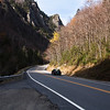A horizontal stock photograph showing a car driving on RT. 3 through Dixville Notch, New Hampshire.