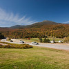 A horizontal stock photograph  of Mt Washington,white mountains of New Hampshire. A beautiful clear autumn day showing automobiles passing by on Rt. 16.