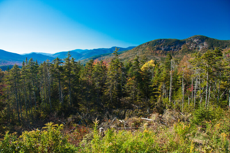 A horizontal stock photograph  of   a fall scenic view off Rt. 112 White mountains New Hampshire. A clear autumn day.