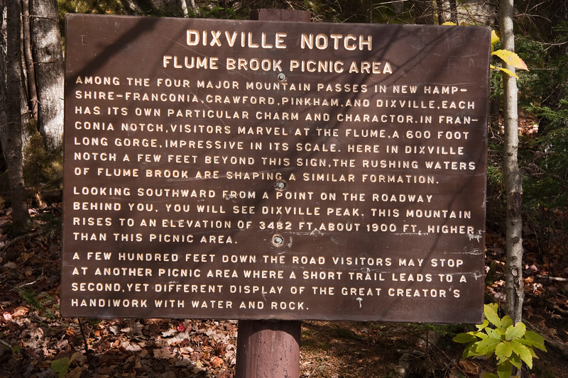 horizontal stock photograph of a sign located at Dixville Notch New hampshire. The sign explains the features of each of the four major notches in New Hampshire
