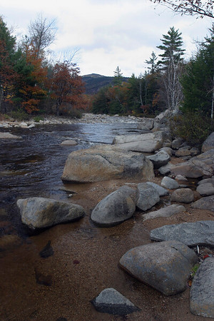 A vertical stock photo showing a scenic view of the Swift river in White Mountains New Hampshire.