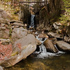 A vertical stock photograph of Flume Brook located in Dixville Notch, New Hampshire