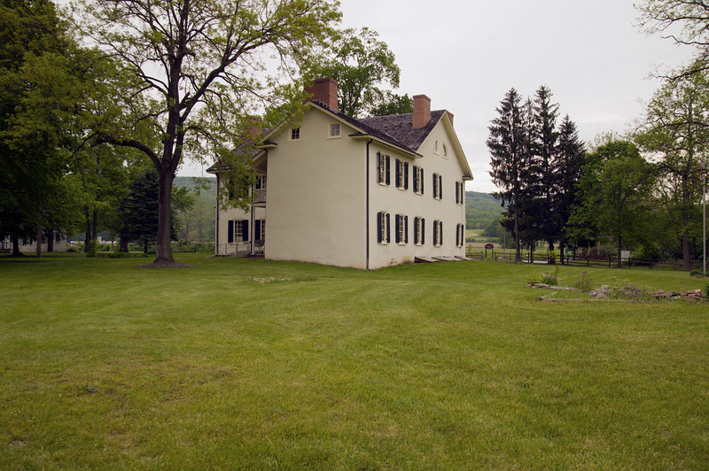 A horizontal stock photograph of the Ironmaster's Mansion at Curtin Villiage Iron works in central Pennsylvania.