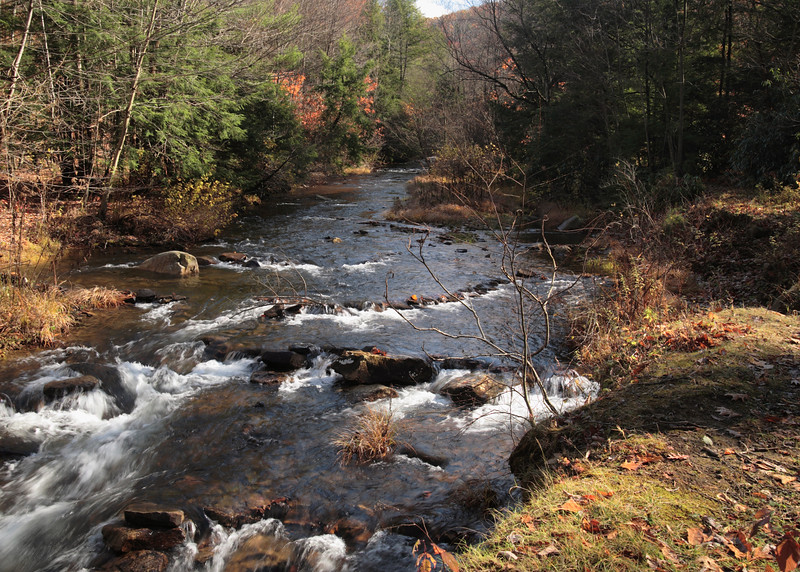 A horizontal stock photograph of a Fall scenic view. Six Mile Run trout stream located near Philipsburg,Pa.
