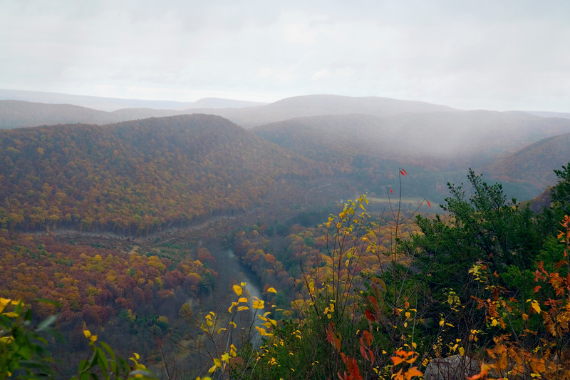 A horizontal stock photograph of a scenic fall  view overlooking Penns valley,Pennsylvania with snow squalls covering the valley.                                                                     w from Hyner view State Park of the west branch Susquehanna River,Pennsylvania.