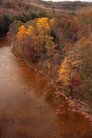 A Vertical Stock Photograph of the Red Moshannon near Snoeshoe Pennsylvania.view from the 110 feet high viaduct railroad bridge.