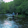 A middle aged man and a teenage boy enjoy trout fishing in Black Moshannon stream. Black Moshannon State Park Pennsylvania.
