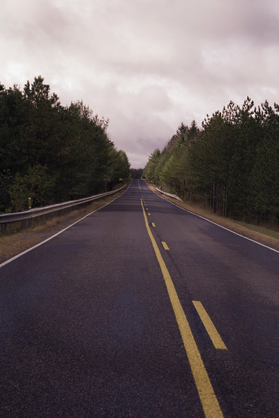 A vertical stock photo of a straight away section of Route 879 in Elk County Pennsylvania.