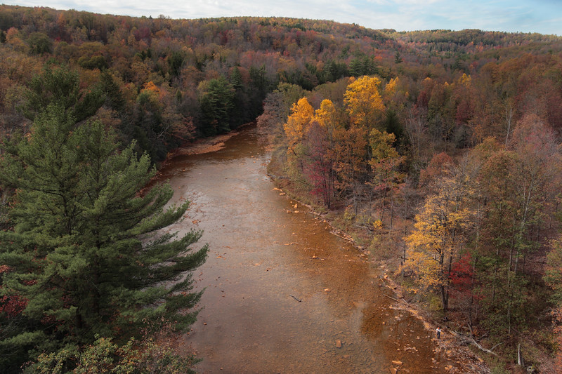 A horizontal Stock Photograph of the Red Moshannon near Snoeshoe Pennsylvania. View from the 110 feet high viaduct railroad bridge.