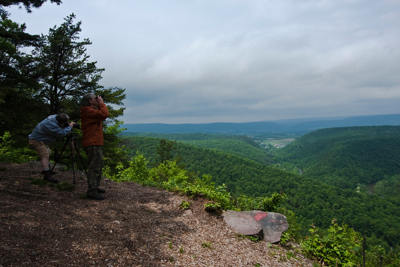 A horizontal stock photograph of two Two men photographing  the view of Penns Valley in Central Pennsylvania