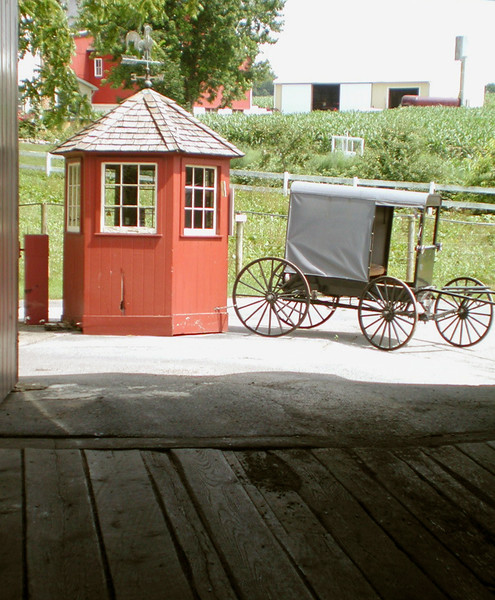 A vertical stock photo of Herr's Mill bridge and Amish buggy Lancaster Pennsylvania.
