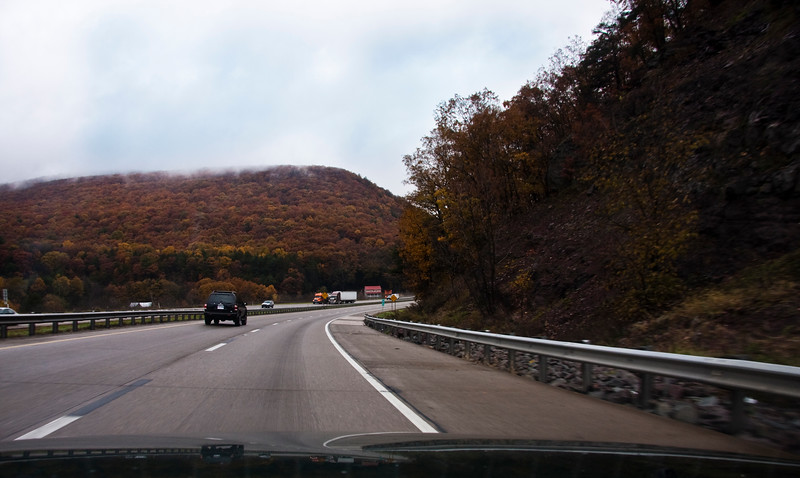 A horizontal stock photograph of  Interstate 80 West bound in central Pennsylvania. Showing traffic.