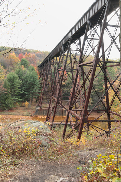 A Vertical Stock Photograph of the viaduct railroad bridge near Snowshoe Pennsylvania showing the solid steel construction.