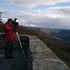 A vertical stock photograph of a photographer capturing the view from Hyner View State park Pennsylvania.