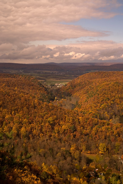 A vertical stock photograph of a scenic Fall view overlooking Penns Valley,Pennsylania showing storm clouds.
