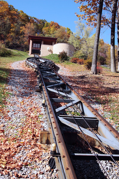 A vertical stock photo looking up the tram tracks at Horseshoe curve in Altoona Pennsylvania. The tram car is called the Funicular.