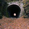 A vertical stock photograph of an abandonded railroad tunnel near Penns Valley Pennsylvania.