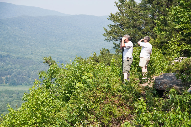 A horizontal stock photograph of a man and women enjoying the view of Penns Valley in central Pennsylvania.