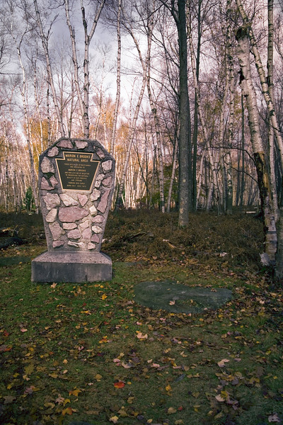 A vertical stock photograph of the stone monument in Marion E. Brooke natural area,Elk County Pennsylvania.