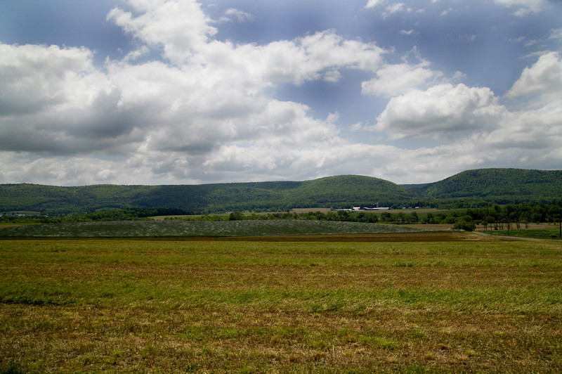 A horizontal stock photo showing a scenic view of farm in central Pennsylvania.