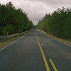 A vertical stock photograph of road going off into the distance. Route 879 Elk County Pennsylvania.