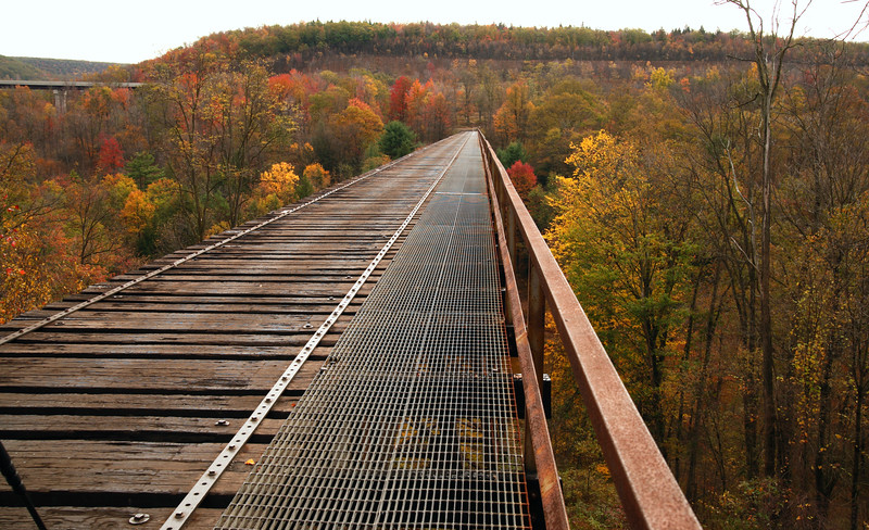 A horizontal Stock Photograph of the old viaduct railroad bridge,spanning the polluted red moshannon river located in Snowshoe Pennsylvania.