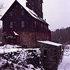 A stock photograph of A vertical stock photograph of the Old Red Mill in Jerico Vermont. Also known as the Chittenden Mill.