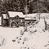 Black and white art photograph.Winter at the gristmill.