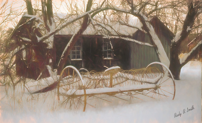 Old hay rake setting in the New England winter.