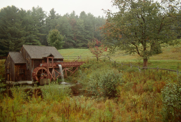 A horizontal stock photo of an overshot water wheel grist mill near Guildhall Vermont.