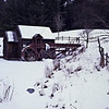 A horizontal stock photograph of a winter scene showing an overshot wheel gristmill near Guildhall Vermont. A cold winter day.