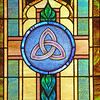 Stained glass triquetra representing the Holy Trinity