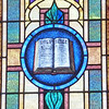 Stained glass window representing the Office of Public Ministry...