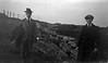 #9b Rowland & George Stebbins by cement bunker & rock wall